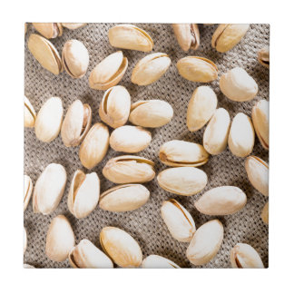 Top view of a group of salty pistachios ceramic tile