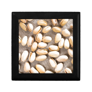 Top view of a group of salty pistachios gift box
