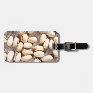 Top view of a group of salty pistachios luggage tag