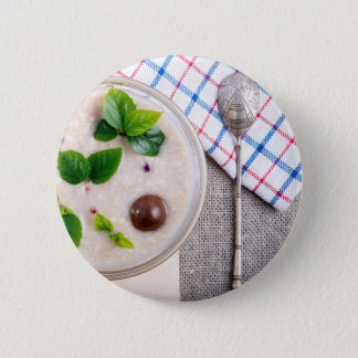 Top view of a healthy dish of oatmeal in a bowl 6 cm round badge
