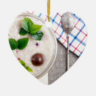 Top view of a healthy dish of oatmeal in a bowl ceramic heart decoration