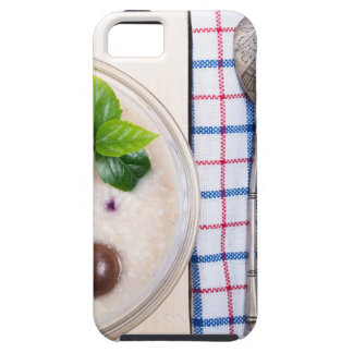 Top view of a healthy dish of oatmeal in a bowl iPhone 5 cover