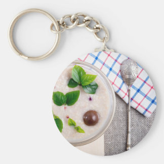 Top view of a healthy dish of oatmeal in a bowl key ring