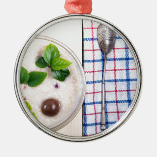 Top view of a healthy dish of oatmeal in a bowl metal ornament