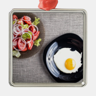 Top view of a healthy homemade breakfast of egg Silver-Colored square decoration