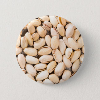 Top view of a lot of salty pistachios 6 cm round badge