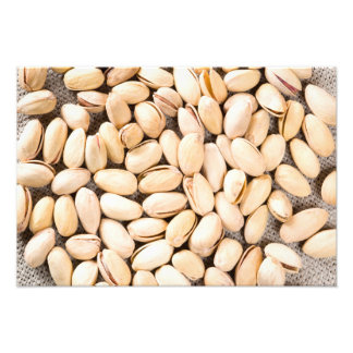 Top view of a lot of salty pistachios photo print