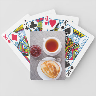 Top view of a plate of hot pancakes with vintage bicycle playing cards