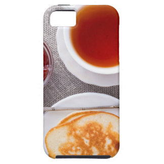 Top view of a plate of hot pancakes with vintage iPhone 5 cover