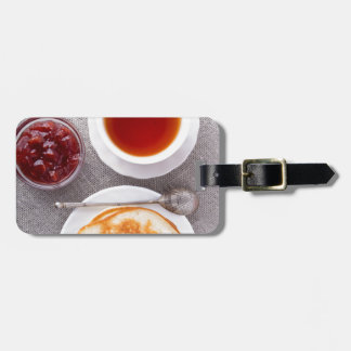Top view of a plate of hot pancakes with vintage luggage tag
