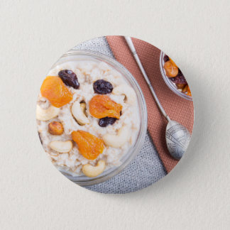 Top view of a portion of oatmeal with fruit 6 cm round badge