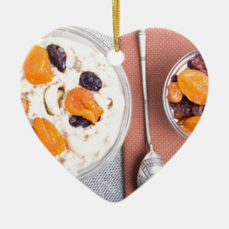 Top view of a portion of oatmeal with fruit ceramic heart decoration