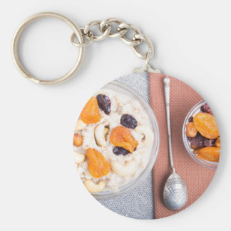 Top view of a portion of oatmeal with fruit key ring