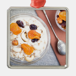 Top view of a portion of oatmeal with fruit metal ornament