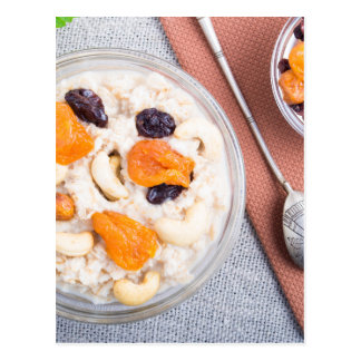 Top view of a portion of oatmeal with fruit postcard