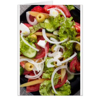 Top view of a salad made from natural vegetables card