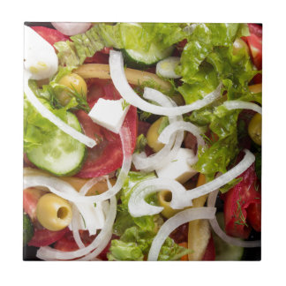 Top view of a salad made from natural vegetables small square tile