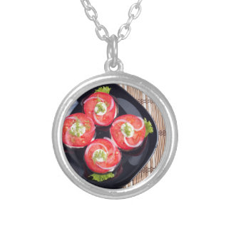 Top view of a sliced red tomatoes slices silver plated necklace