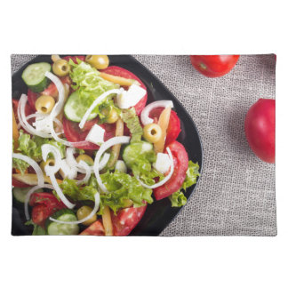 Top view of a small bowl of vegetables salad placemat