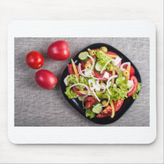 Top view of a small plate of raw salad mouse pad