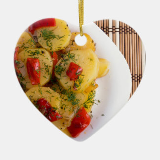 Top view of a vegetarian dish with organic vegetab ceramic heart decoration