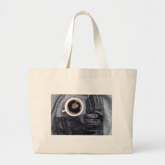 Top view of a white cup of coffee and black gloves large tote bag