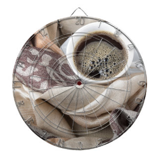 Top view of a white cup of hot coffee dartboard