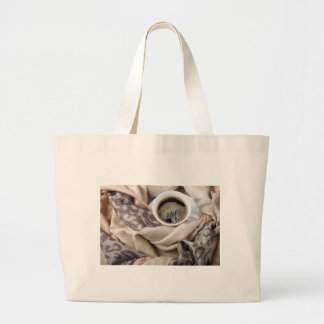 Top view of a white cup of hot coffee large tote bag