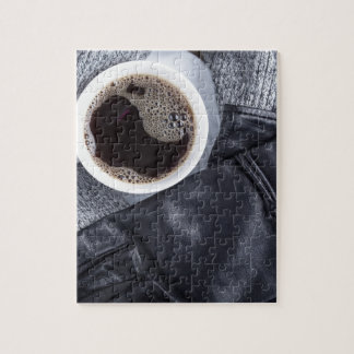 Top view of a white cup with coffee jigsaw puzzle