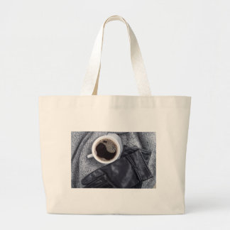 Top view of a white cup with coffee large tote bag