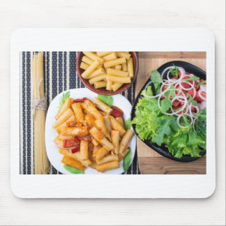 Top view of cooked rigatoni pasta with vegetables mouse pad
