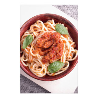 Top view of cooked spaghetti with tomato relish customised stationery