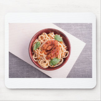 Top view of cooked spaghetti with tomato relish mouse pad
