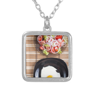 Top view of homemade meals on the table silver plated necklace