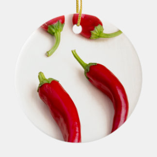 Top view of hot chili peppers round ceramic decoration