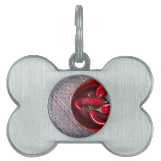 Top view of hot red chili peppers in a brown wood pet tag