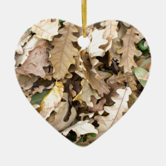Top view of the fallen oak leaves closeup ceramic heart decoration