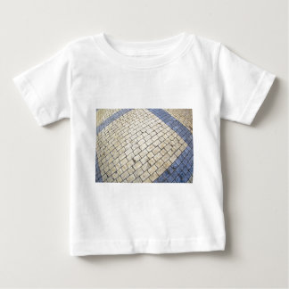 Top view of the pavement of rectangular stones tee shirt