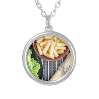 Top view of the spaghetti, pasta and lettuce silver plated necklace