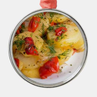 Top view of the vegetarian dish of organic potato metal ornament