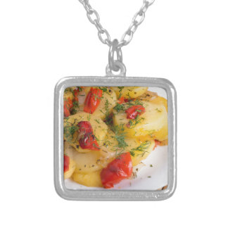 Top view of the vegetarian dish of organic potato silver plated necklace