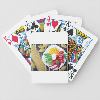 Top view of the vegetarian dish of raw vegetables bicycle playing cards