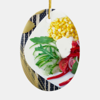 Top view of the vegetarian dish of raw vegetables ceramic oval decoration