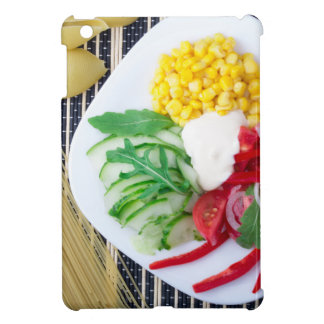 Top view of the vegetarian dish of raw vegetables iPad mini cases