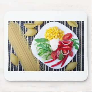 Top view of the vegetarian dish of raw vegetables mouse pad