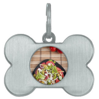 Top view on a fresh vegetable salad with natural pet ID tag