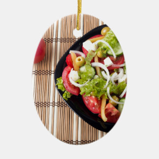 Top view on a healthy and natural vegetable salad ceramic oval decoration
