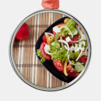 Top view on a healthy and natural vegetable salad Silver-Colored round decoration