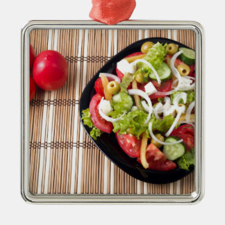 Top view on a healthy and natural vegetable salad Silver-Colored square decoration