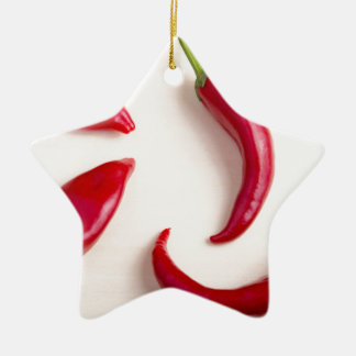 Top view on a hot red chili peppers ceramic star decoration